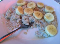 Steel cut oatmeal dressed with bananas, organic honey and walnuts.