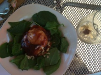 English muffin topped with slow cooked pork, baby arugula, poached egg and blueberry infused BBQ hollandaise sauce.